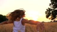 HD SUPER SLOW-MOTION: Girl Running In Field At Sunset