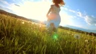 SUPER SLO-MO Girl Running In The Meadow At Sunset