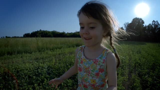 Girl Running In The Meadow At Sunset