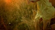 LA TS SLO MO Girl Running In The Meadow