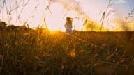 SLO MO Girl Running In The Sunrise