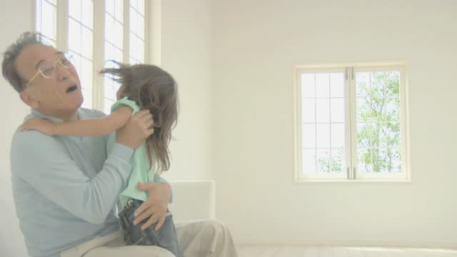 Girl running to grandfather