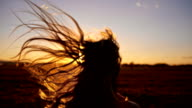 SLO MO Girl running toward the sun