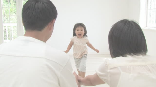 Girl running up to parents