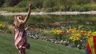 SLO MO WS Girl (12-13) running with kite in park / Utah, USA