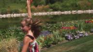 SLO MO MS DS. TU Girl (12-13) running with kite in park / Utah, USA