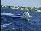 MONTAGE Girl sailing Sunfish capsizes. Twp men struggle with sail on Sunfish. One climbs on as it sails away / Bermuda