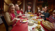 POV girl showing funny dance to family at Christmas dinner