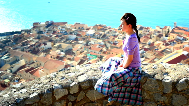 girl sitting at the cliff