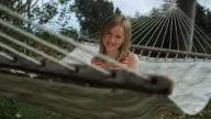 girl sitting on a hammock