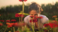 HD: Girl smells the flowers