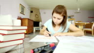 Girl studying and underlining important facts
