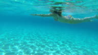 Girl swimming in the turquoise sea