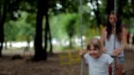 Girl swinging on a swing