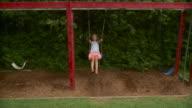 WS Girl (8-9) swinging on playground swing / Stowe, Vermont, USA
