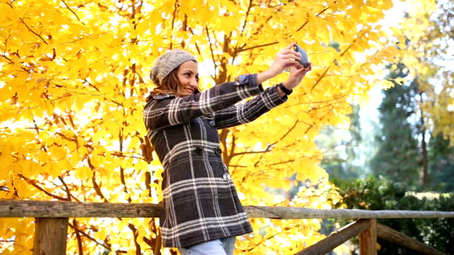 Girl taking a selfie in the park
