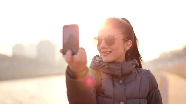 Girl Taking Self Portrait on Cell Phone
