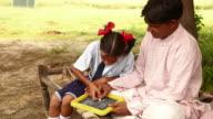 Girl teaching to her father, Haryana, India