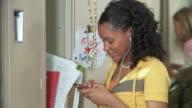 CU, PAN, Girl (12-13) text messaging before running away from school lockers, Richmond, Virginia, USA