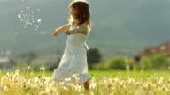 SUPER SLO-MO Girl Throwing Dandelion Seeds