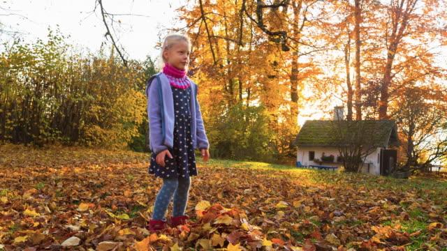 Girl Tossing Leaves
