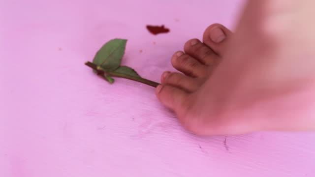 Girl trample red rose