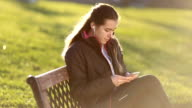 Girl typing messages and listening music