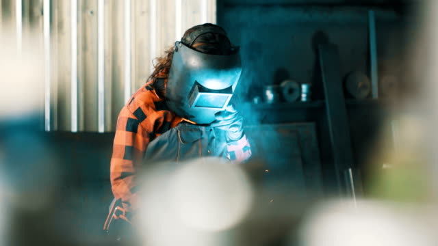 Girl using a welding machine