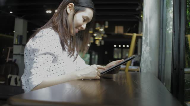 girl using computer at cafe