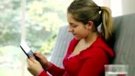 Girl using digital tablet.