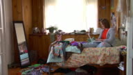 MS ZI girl using laptop on bed in messy bedroom/ ZO girl