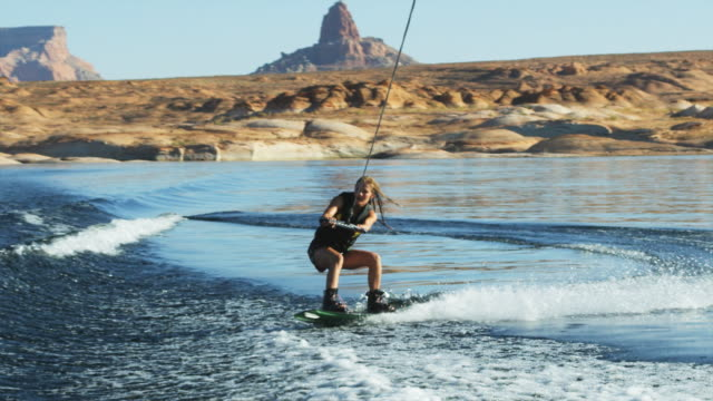girl wake boarder crashing