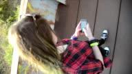 Girl walks with smartphone
