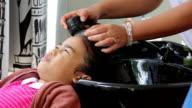 girl washing hair in salon