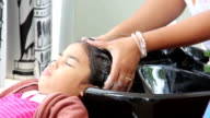 girl washing hair in salon
