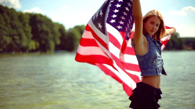Girl waving the american flag.