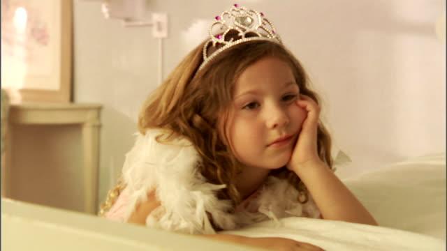 CU, ZI, Girl (4-5) wearing tiara and feather boa