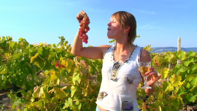 girl, wine and grapes