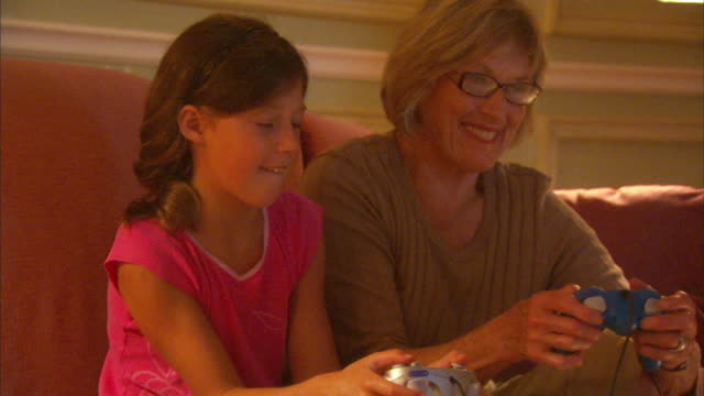 CU Girl (8-9) with grandmother playing video game, Halifax, Nova Scotia, Canada