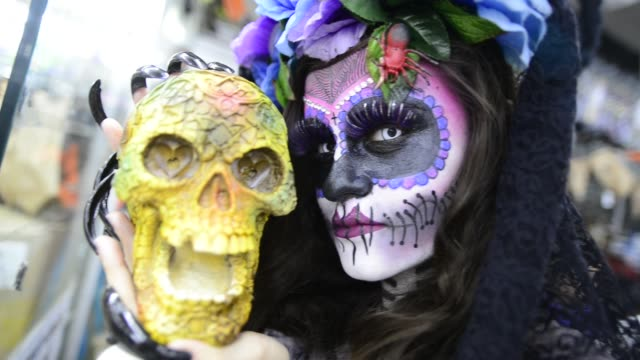 A girl with makeup of 'La Calavera Catrina' in Sao Paulo on October 28 2016
