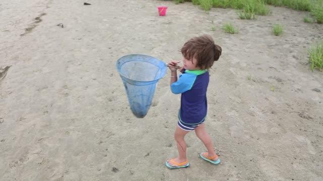 girl with net on beach