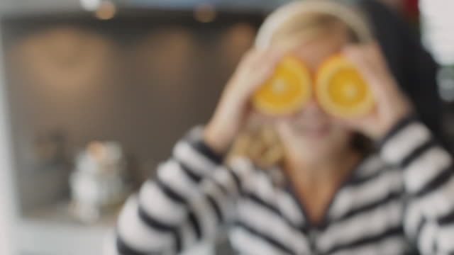 CU Girl (10-11) with orange slices in front of eyes / Kleinmachnow, Brandenburg, Germany
