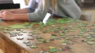 girl working on a puzzle