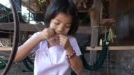 MS TD Girl working with Hands spinning wheel / Rangoon, Myanmar