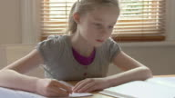 MS Girl (8-9) writing at desk / Chislehurst, Kent, UK