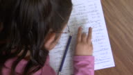 CU, HA, Girl (8-9) writing mathematics in classroom