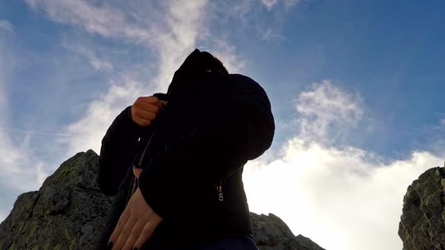 Girl zipping up jacket 4K