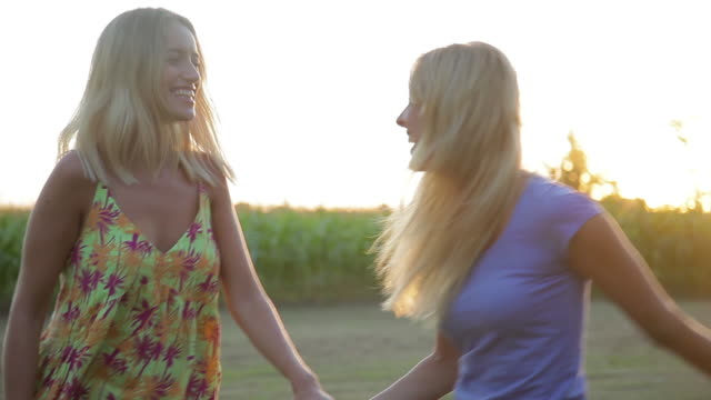 Girlfriends walking and laughing together outdoors