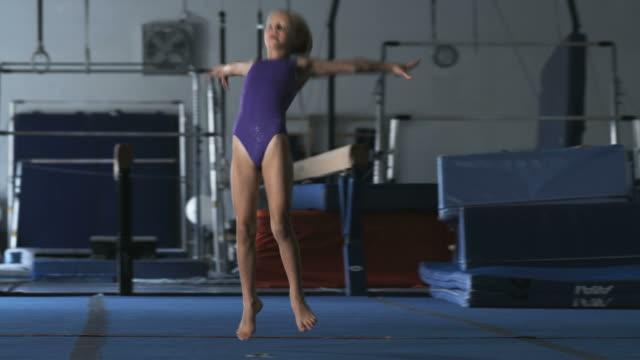 WS PAN Girls (8-9) doing somersaults in gym, Orem, Utah, USA