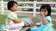 Girls eat ice cream.
